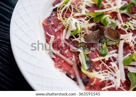 prosciutto with herbs and black truffle  - stock photo