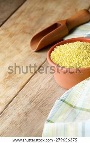 Proso grains on the kitchen table - stock photo