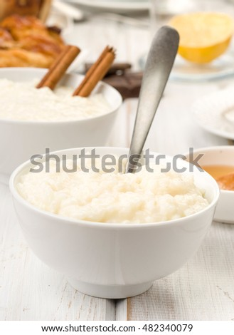prospect of overflowing bowls of rice pudding, on white wood
