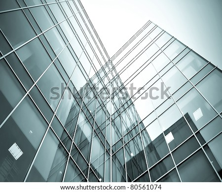 prospective view to glass high-rise black building skyscrapers at night - stock photo