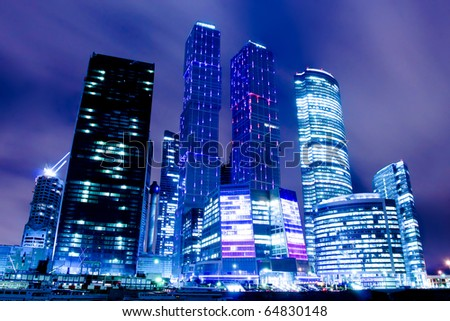 prospective view to glass high-rise building skyscrapers at night