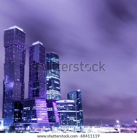 prospective view to glass high-rise building skyscrapers at night - stock photo