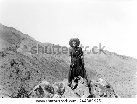 Prospector Mrs. Clara Dunwoody on her variscite mining claim near Sodaville in Mineral County, Nevada. May 1910. Variscite is a semi-precious stone similar to turquoise. - stock photo
