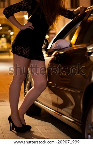 Prostitute encouraging man to use her service - stock photo