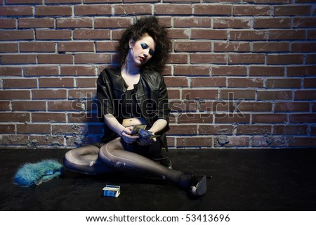 prostitute girl near brick wall counting money - stock photo