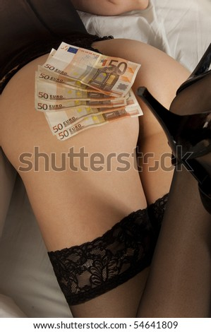 prostitute with banknote on her ass - stock photo
