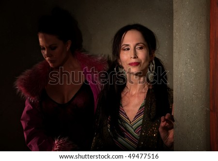 Prostitutes in hallway waiting for their customers - stock photo
