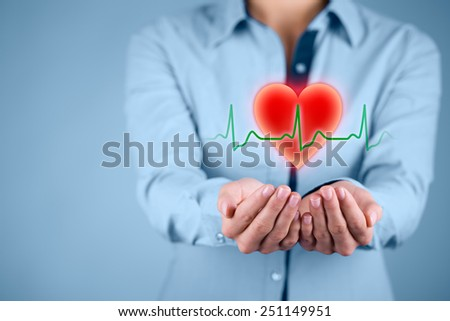 Protect health (healthcare) and heart problems prevention (cardiology) concept. Cardiologist with protective gesture and symbol of heart and ECG heartbeat. - stock photo