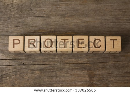 PROTECT text on a wooden background - stock photo