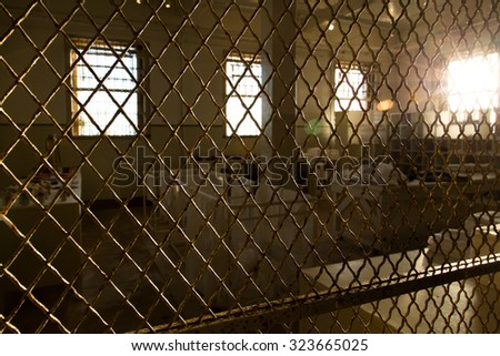 Protected by a metal mesh and covered by the evening sun, it produces a melancholy feeling room and interesting drama - stock photo