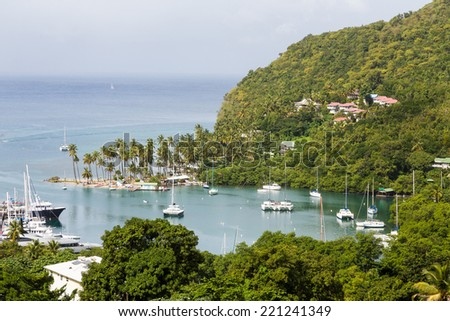Protected cove on St Lucia with yachts and sailboats - stock photo