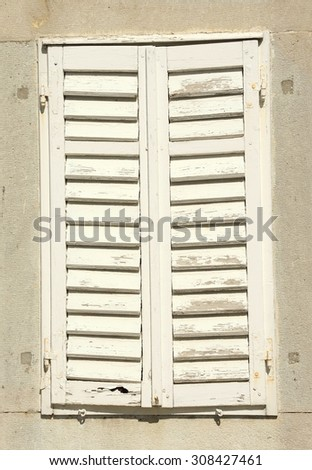 Protected window / Old wooden window on old wall / Wooden Shutters