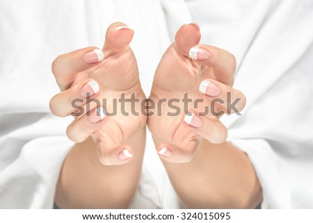 Protecting hands. Space to insert your objects between hands. - stock photo