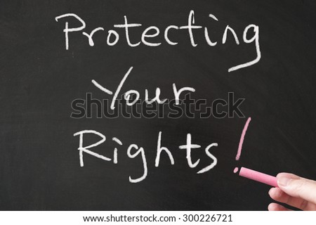 Protecting your rights words written on blackboard using chalk - stock photo