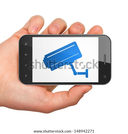 Protection concept: hand holding smartphone with Cctv Camera on display. Generic mobile smart phone in hand on White background. - stock photo