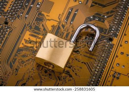 Protection concept : security lock on computer circuit board - stock photo
