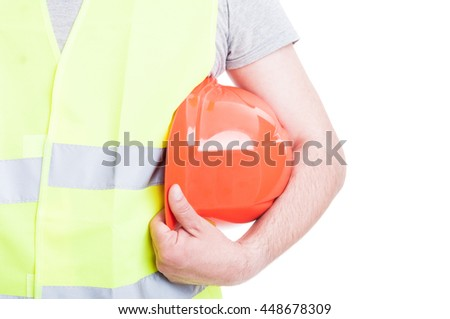 Protection equipment concept with vest and hardhat in young constructor hand isolated on white background - stock photo