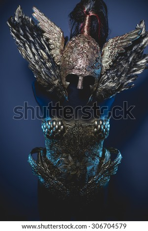 Protection, fantasy warrior armor, golden armor and feathers - stock photo