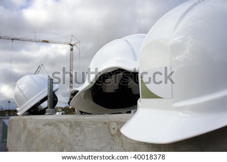 Protection has hats on a building - stock photo