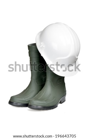 Protection helmet and rubber boots isolated over white with clipping path. - stock photo