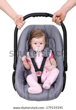 Protection of children. Children in a child car seat in the hands of her father and mother. - stock photo