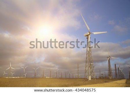 Protection of nature.Eco power, wind turbines over blue sky. sunset of windfarm