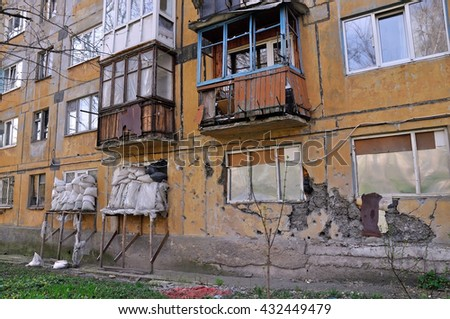 Protection residential house against shelling in Donetsk, Ukraine. Sandbags in front of windows