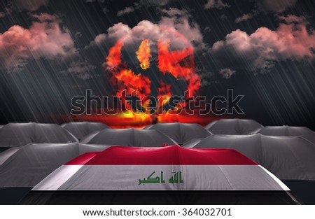 Protection Umbrella with flag of Iraq on a money war background - stock photo