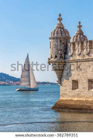 Protective corner turret on the Tower of Belem (Torre de Belem), the river Tejo (Tagus) with whitw sial in the background - Lisbon, Portugal - stock photo