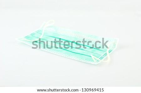 Protective face mask on white background - stock photo