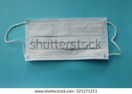 Protective face mask - surgical mask - on blue background