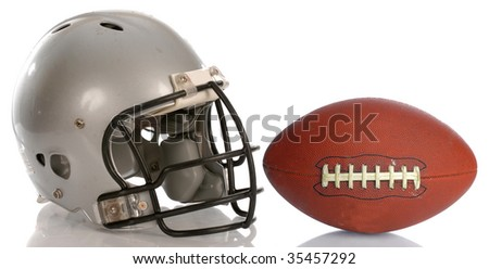 protective football helmet and leather football with reflection - stock photo
