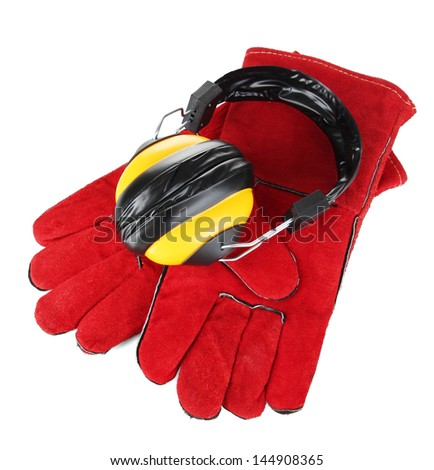 Protective gloves and headphones isolated on white