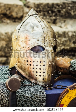 Protective helmet with a visor on medieval knight. Medieval Templar helmet waiting for knight - stock photo