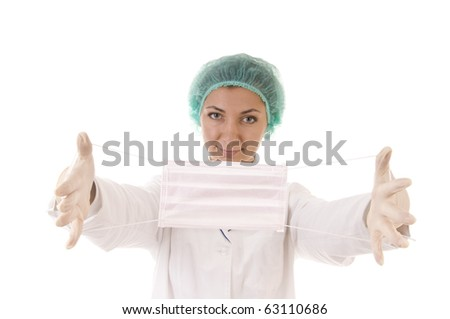 Protective mask in hands of woman doctor. Focus on the mask. Isolated on white. - stock photo