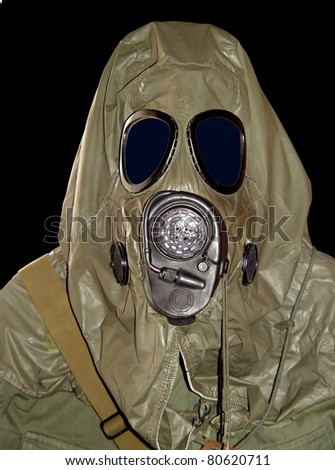 Protective military chemical warfare suit against black background. - stock photo