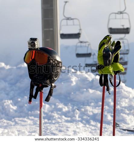 Protective sports equipment on ski poles at ski resort at sunny day. Caucasus Mountains. Georgia, ski resort Gudauri. - stock photo