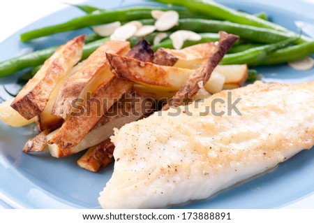 protein rich tilapia fish fillet with vegetables,a diet conscious meal - stock photo