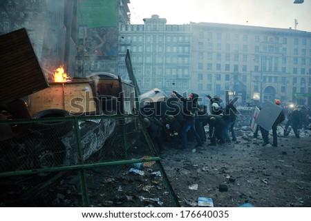 Protesters attack police. Kyiv, Ukraine, January 20, 2014 - stock photo