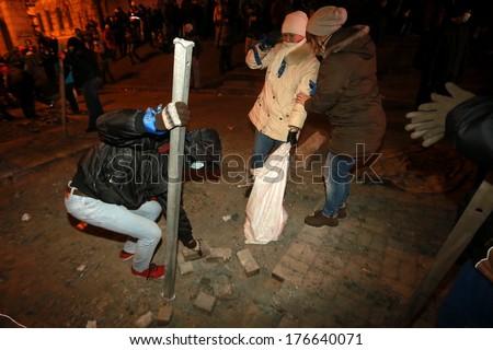 Protesters break stone blocks to use it as a weapon. Kyiv, Ukraine, January 19, 2014 - stock photo