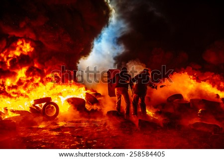 Protesters on fire with Molotov cocktails - stock photo