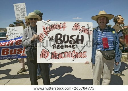 Protestor in Tucson Arizona of President George W. Bush holding a sign protesting his Health Care plans  - stock photo