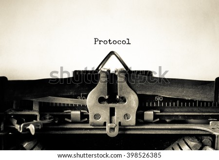 Protocol words typed on a vintage typewriter - stock photo