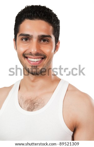 protrait of a handsome man wearing vest, Indian man with a muscular body - stock photo