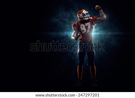 Proud american football player  i dark - stock photo