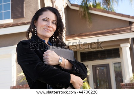 Proud, Attractive Hispanic Real Estate Agent Woman in Front of New Home. - stock photo
