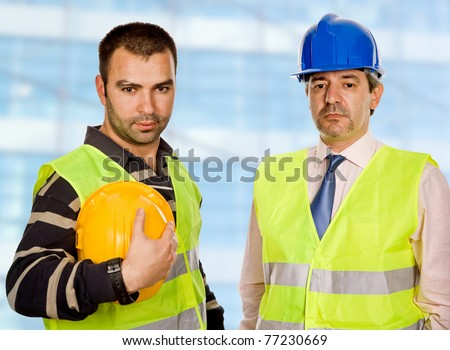 proud boss and worker standing looking at the camera - stock photo