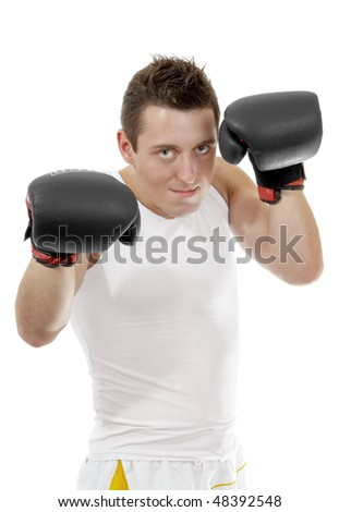 Proud boxer with boxing gloves after the fight - stock photo