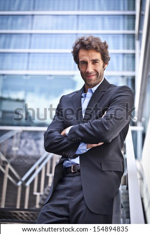 Proud Businessman In Front Of His Office - stock photo