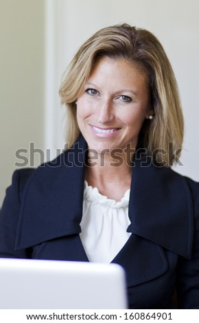 Proud Businesswoman At Home Office Using Laptop - stock photo